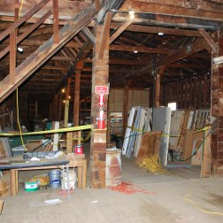 West end | Upper level looking at former stair to mezzanine - Before